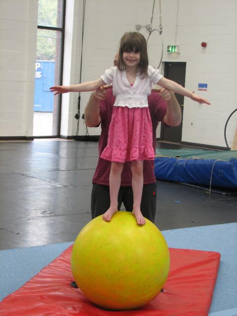Summer balances on a ball