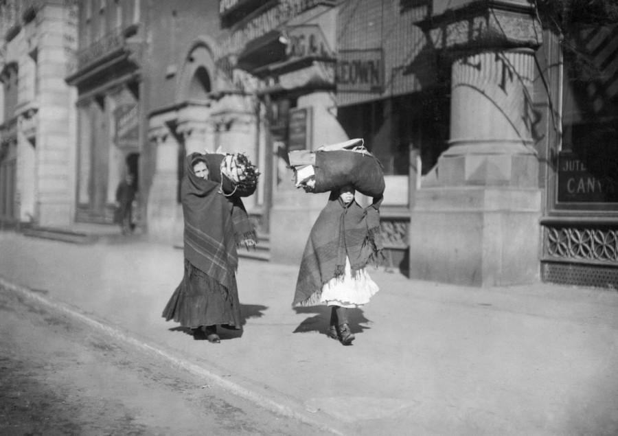 Lewis Hine - Heavy loads of garments for home-work. Near Bleeker St., New York, New York, 1912