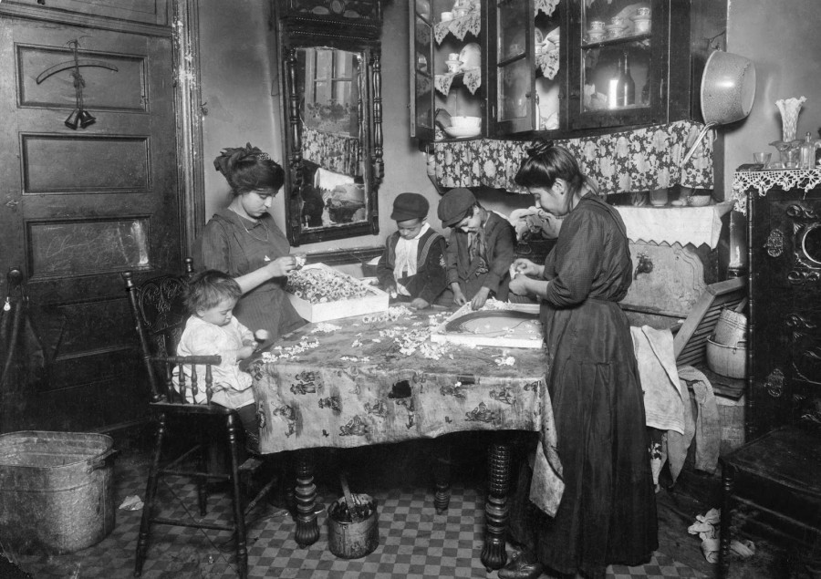 Lewis Hine - Family of Mrs. Mette making flowers in a very dirty tenement. New York, New York, 1911