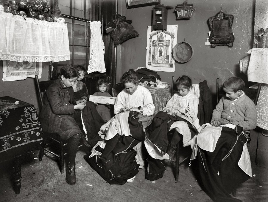 Lewis Hine - Family of Onofrio Cottone, 7 Extra Place, New York, finishing garments in a terribly run down tenement, 1913