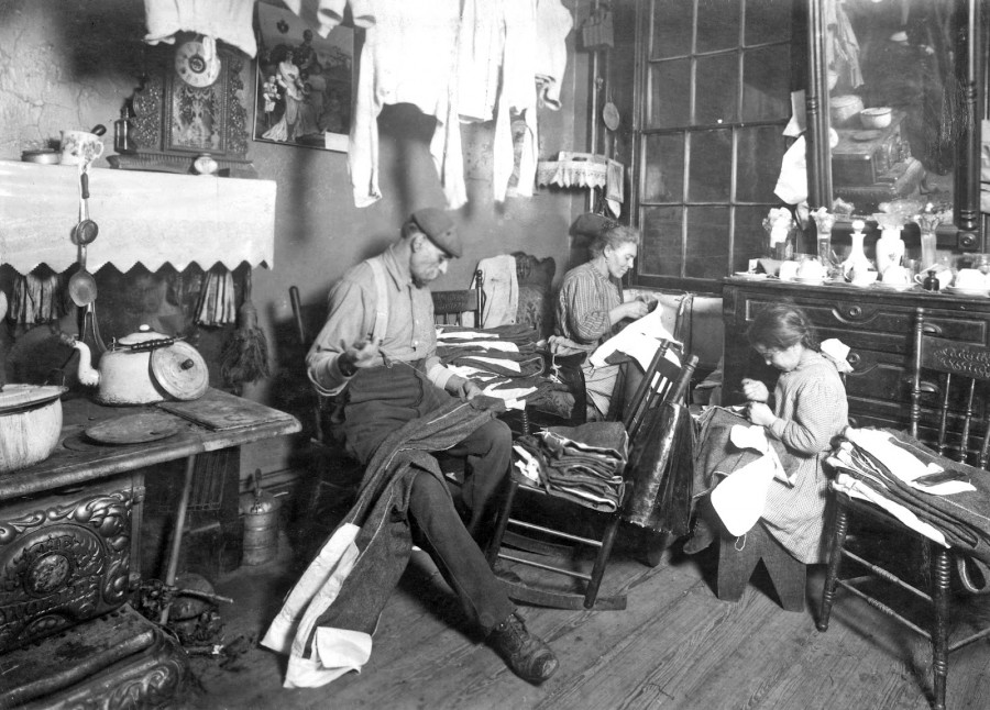 Lewis Hine - Jennie Rizzandi, 9 year old girl, helping mother and father finish garments in a dilapidated tenement. New York, New York, 1913