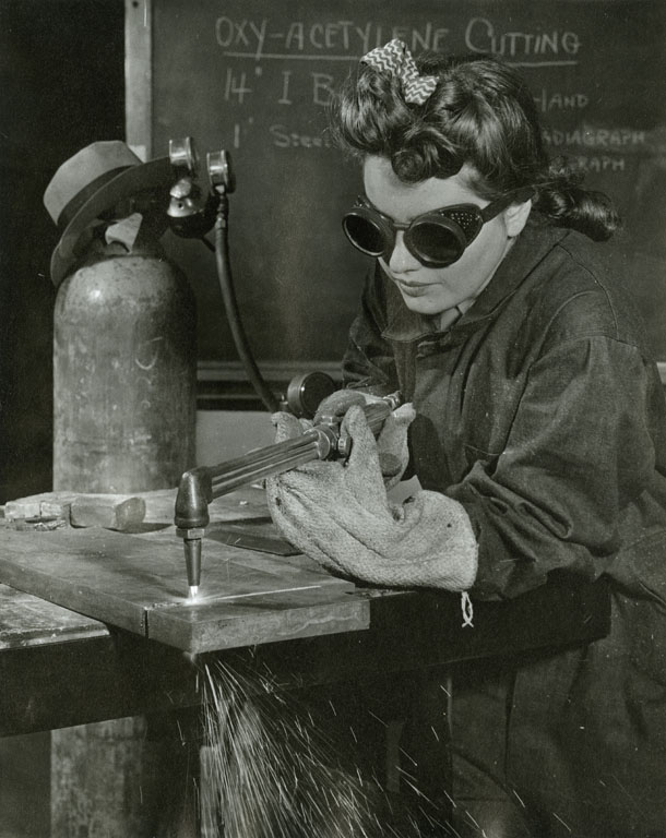 Female student at Pratt Institute, Brooklyn, working with an oxy-acetylene cutter