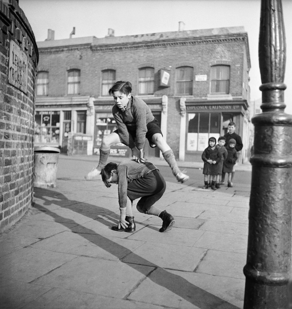 Boys playing in the street, London, England, 1953