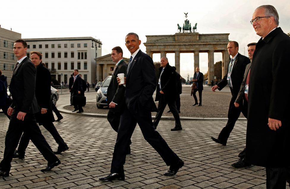 President Barack Obama walks past the Brandenburg Gate