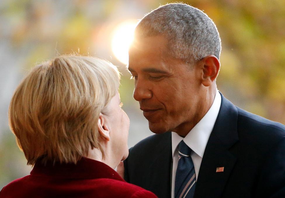 President Barack Obama is welcomed by German Chancellor Angela Merkel