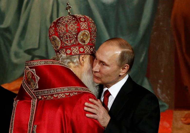 Patriarch Kirill, the head of the Russian Orthodox Church, embraces Russian President Vladimir Putin during the Orthodox Easter service at the Christ the Saviour Cathedral in Moscow © Reuters