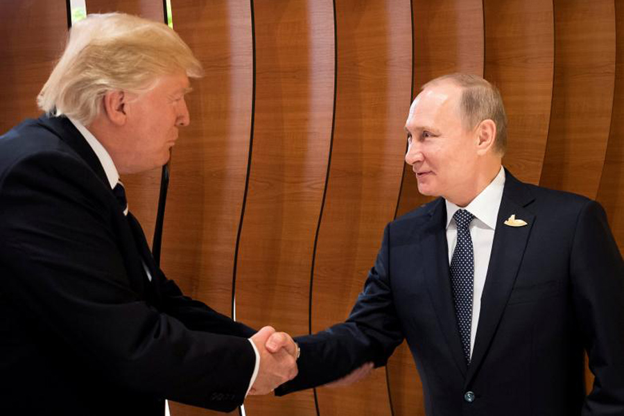 Donald Trump and Vladimir Putin shake hands