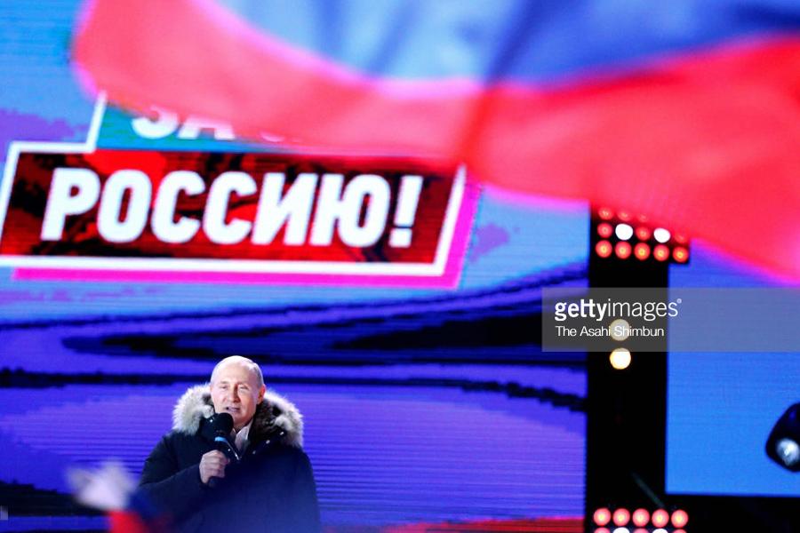 Putin attends a rally
