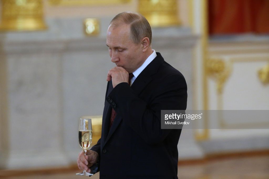 Putin holds a glass