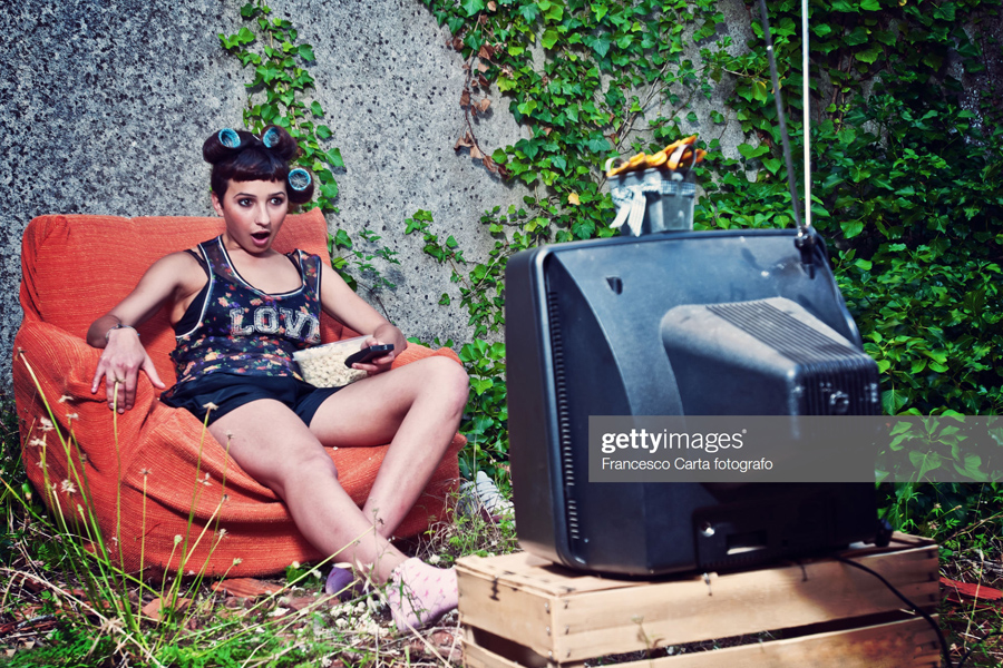 Young woman looking TV