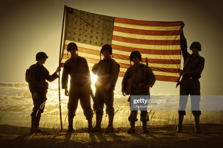 Soldiers with American flag