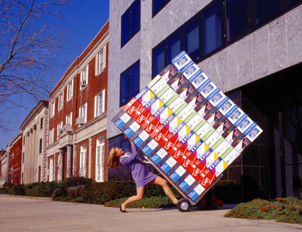 Woman delivering brand boxes