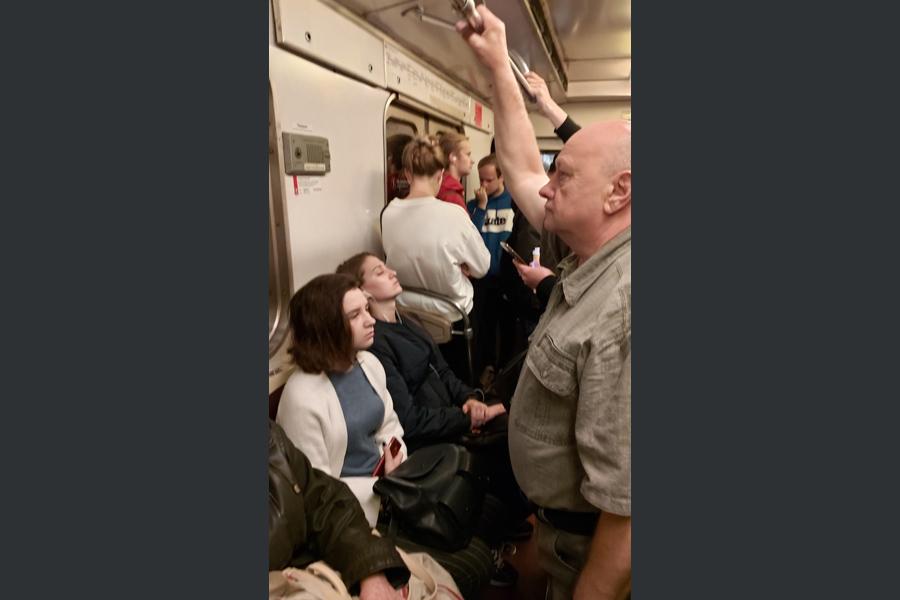 Man-Stand-Girl-Seat-Metro