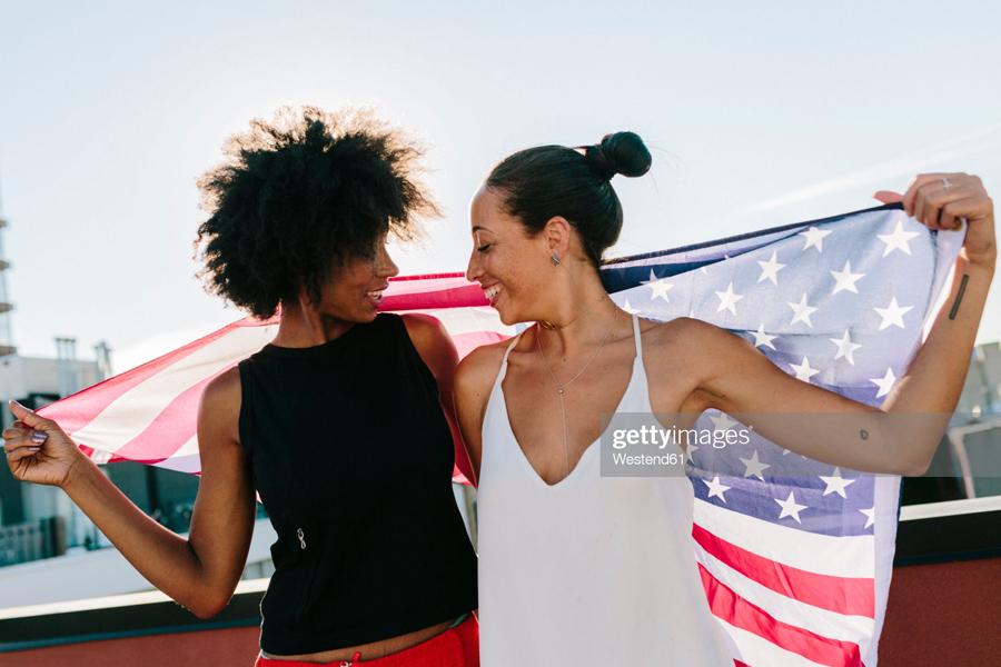 Female holding US flag