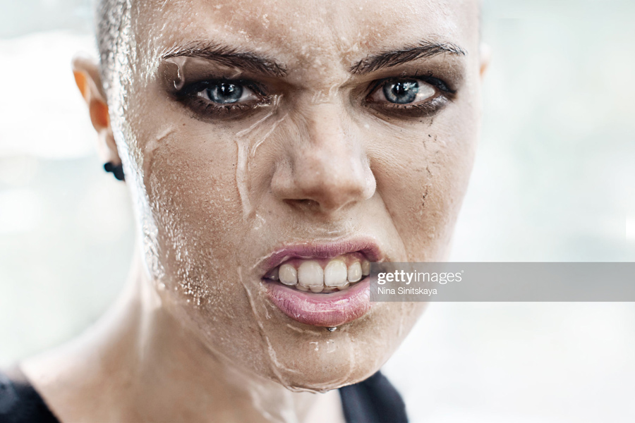 Woman crying under the rain