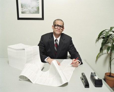 Businessman checking large document