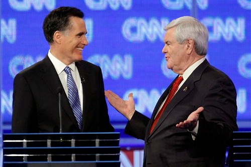 Gingrich and Romney smile