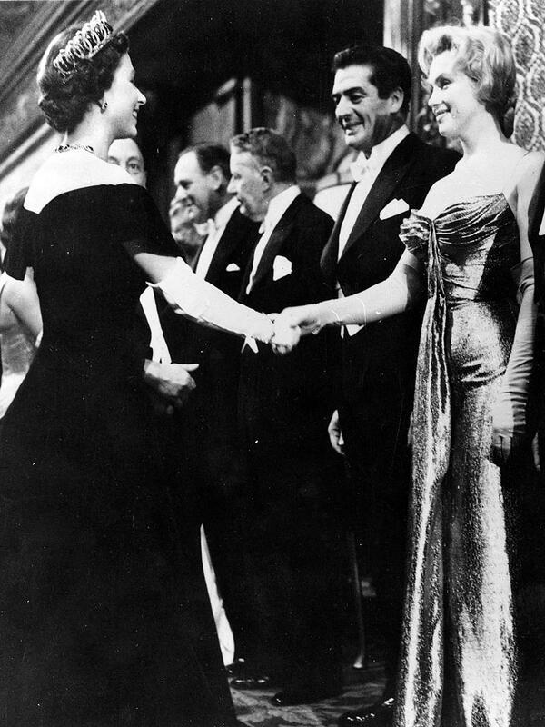 M_Monroe_Queen_Elizabeth_both_30_at_the_time_meet_at_a_movie_premier_in_London_October_1956.