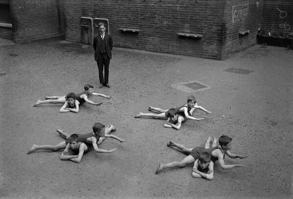 Children_learn_swim_schoolyard_England_early_1920s