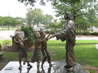 Jesus welcoming the little children