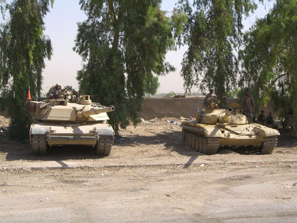 M1_Abrams_and_T72_by_DOGZOVWAR81