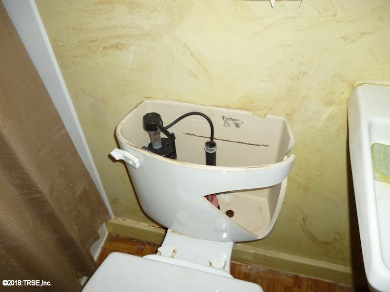 broken_toilet_tank_03_04_2018.jpg