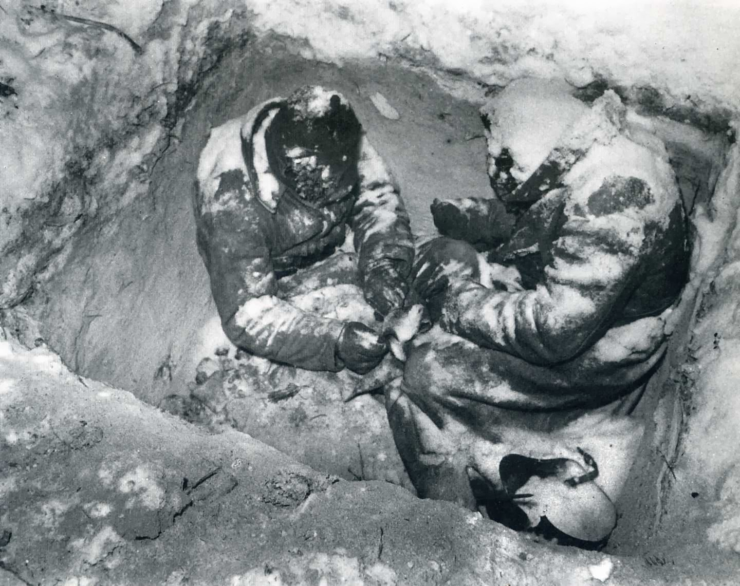 Two Soviet infantrymen who froze to death in their fox hole, Finland, 1940