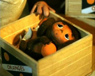 Cheburashka in the market-place box