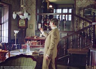 Vasily Livanov as Sherlock Holmes in the interior of 221b in Lenfilm series