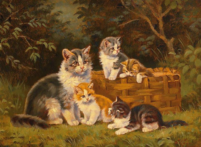 Katzenfamilie mit Weidenkorb am Waldrand