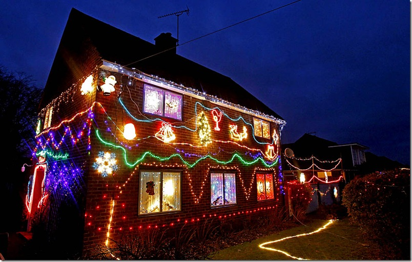 A home is illuminated with Christmas lights in a street in the village of Westfield near Hastings in southern England,  December 15, 2010.