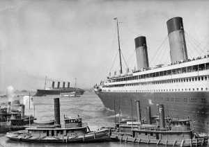 New York. June 21, 1911. White Star liner S.S. Olympic guided by tugboats Kirkham and Admiral. RMS Lusitania behind. Detroit Publishing glass negative