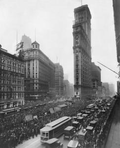People gather outside The New York Times building in Times Square to get World Series results from a remote scoreboard in October, 1919