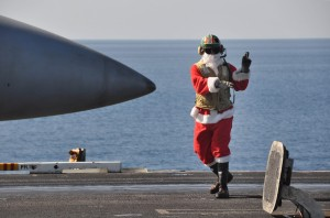US_Navy_091225-N-8421M-103_t._Jon_Sunderland__Santa_suite_while_directing_aircraft_operations_aboard_USS_Nimitz_(CVN_68)_Christmas_Day (USN photo Mass Communication Specialist 1st Class David Mercil