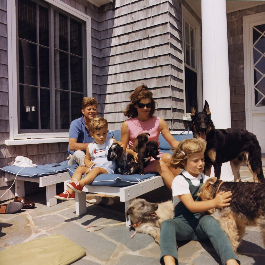 Hyannisport Weekend. JFK and wife, Caroline Kennedy. Dogs - Clipper (stand), Charlie (wth Caroline) Wolf (reclining ) Shannon (wth John Jr) 2 of Pushinka's puppies (with Jackie) Aug 14 1963