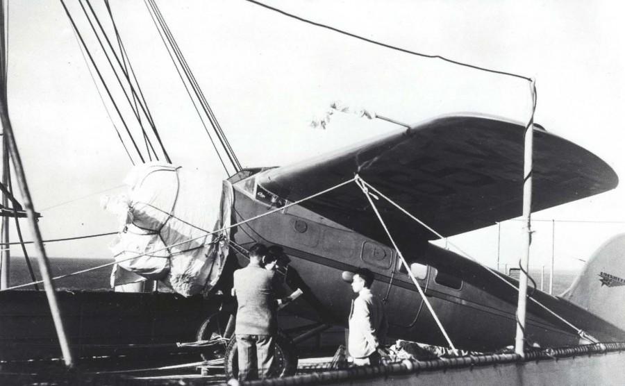 Amelia Earhart Putnam's Lockheed Vega monoplane rests on the deck of the Lurline upon arrival in Hawaii, December 27, 1934
