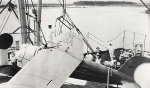 Amelia Earhart's plane was harnessed up by specially constructed slings to lift it from the deck of the Lurline, December 27, 1934