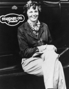 Amelia Earhart sits on the running board of a Standard Oil fueling truck, at Wheeler Field, 1935