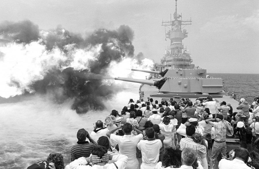 Guests attending a Dependents Day Cruise aboard the battleship USS MISSOURI (BB 63) cover their ears as the ship fires its Mark 7 16-inch 50-caliber guns during a firepower demonstration, 08-24-1988 b