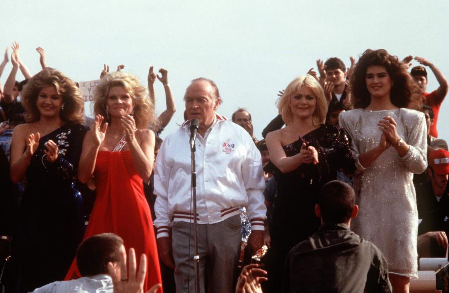 USS New Jersey (BB-62), 24 Dec 1983. Miss USA Julie Hayek, Cathy Lee Crosby, Bob Hope, Ann Jillian and Brooke Shields, during a Christmas Eve USO show