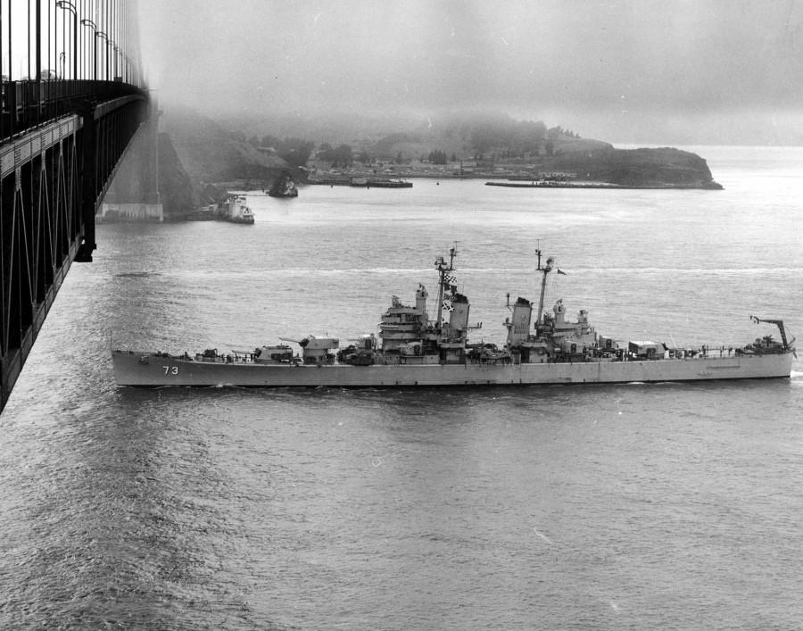 USS Saint Paul (CA-73) under the Golden Gate Bridge, San Francisco, California, United States, Sep 1951