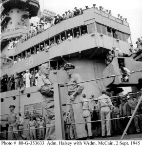 Admiral William F. Halsey and Vice Admiral John S. McCain chatting by the rail on Missouri (BB-63), after the conclusion of of the surrender ceremonies, 2 September 1945