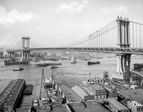 New York circa 1910 - River Traffic. Manhattan Bridge and East River from Brooklyn