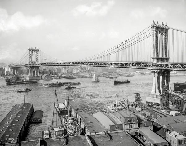 New York circa 1910 - River Traffic. Manhattan Bridge and East River from Brooklyn