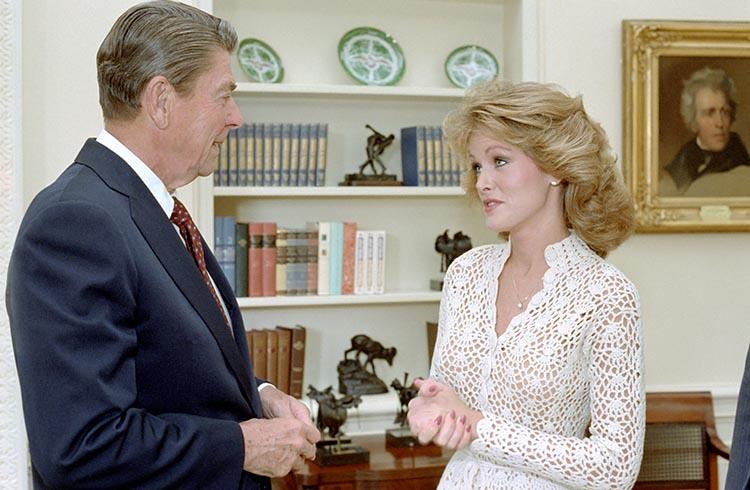 President Reagan with Miss America Debra Sue Maffett in oval office 29 Sept 1982