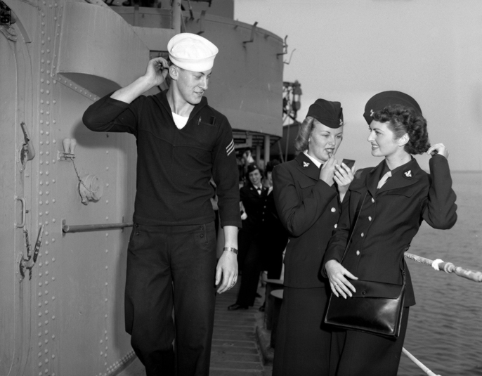 Fireman 1st Class Samuel E.Adolt, 19 with WAVES Marion Koopman left and Margaret Williams aboard the USS Uhlmann (DD-687), Terminal Island, CA, 1950