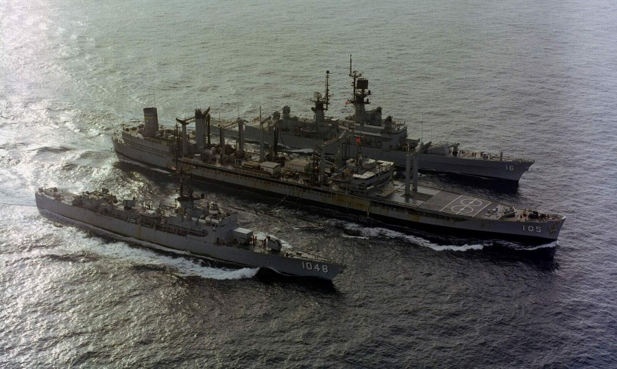 USNS Mispillion (T-AO-105) refueling the U.S. Navy guided missile cruiser USS Leahy (CG-16) and the frigate USS Sample (FF-1048) on 1 December 1980
