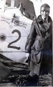 Young Amelia posing with a plane, circa 1922