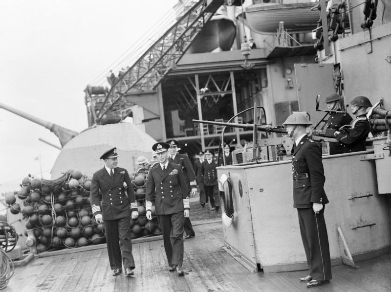 HM King George VI on a tour of inspection of HMS Malaya during a visit to the Home Fleet at Scapa Flow, 13 August 1943