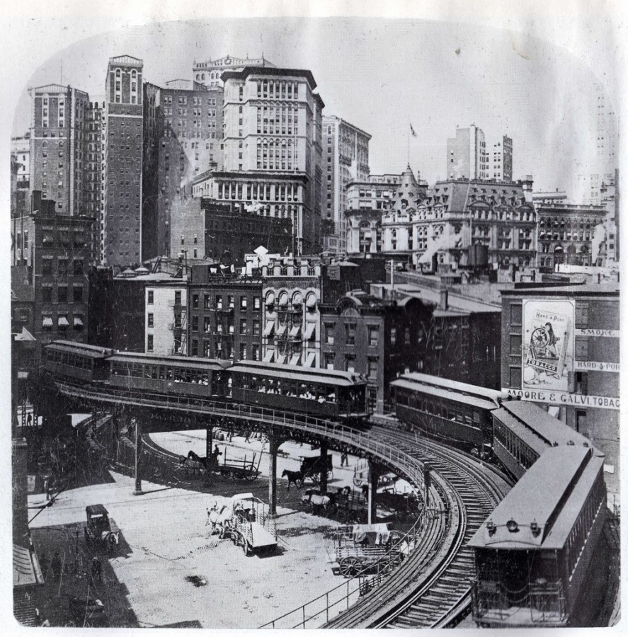 The vertical city on process. View of financial district with many 15 to 20 stories high office buildings and the start of Third Avenue 'El'. May 1904.